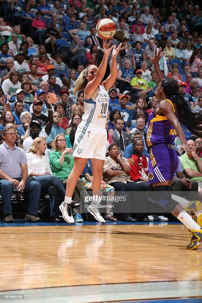Tricia Liston #20 of the Minnesota Lynx goes for the shot against Candice Wiggins #2 of the Los Angeles Sparks during the WNBA game on July 8, 2014 at Target Center in Minneapolis, Minnesota.