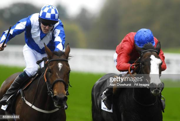 Trick or Treat ridden by Tom Queally win The Princess Royal Willmott Dixon Stakes from Queens Best and Ryan Moore at Ascot Racecourse Berkshire