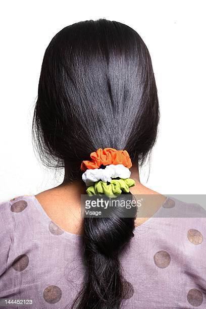 Tri-colored rubber bands on woman's hair