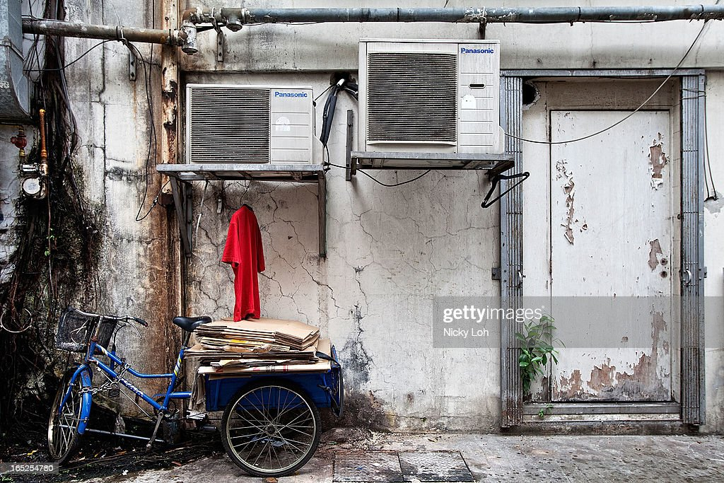 A tricycle is parked behind a shophouse along Club Street on April 2, 2013 in Singapore. A shophouse is a vernacular architectural building type that is commonly seen in areas such as urban Southeast Asia. Shophouses are mostly two or three stories high, with a shop on the ground floor for mercantile activity and a residence above the shop. This pre-industrial form of urban units, prevalent in 19th and early 20th century Southeast Asian towns, cities and commercial centres, literally housed everything from work to home. Today, these buildings are recognised for their significance not only as an architectural heritage but more importantly as a reflection of the island's societal history and development.