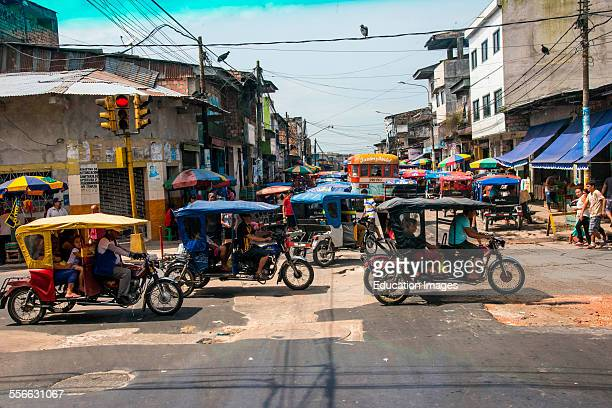 Tricycle taxis fill street in Iquitos Peru