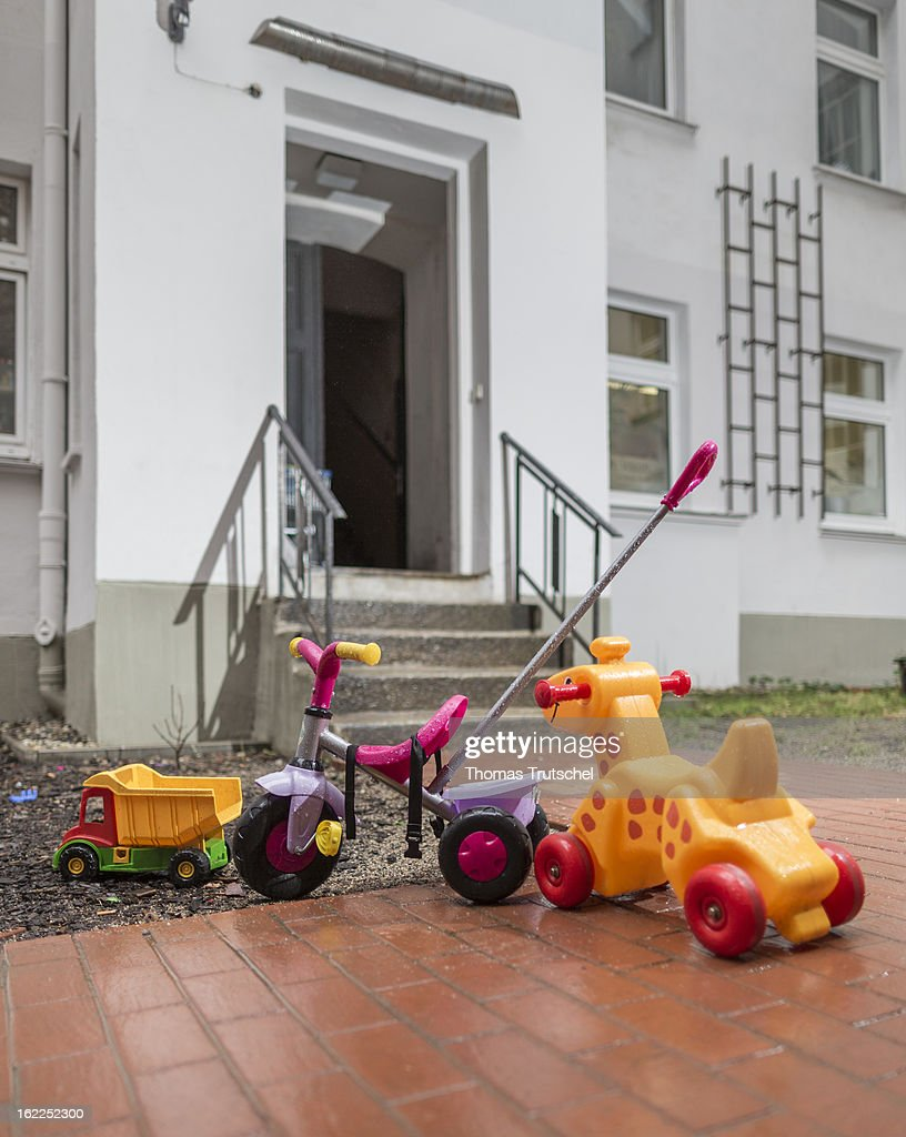 A tricyle and children's toys pictured at the entrance to an apartment block on February 04, 2013 in Berlin, Germany.
