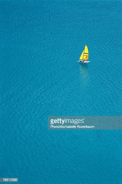 Trimaran sailing in blue sea, aerial view