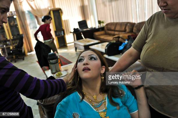 Trina Amiri the actress getting her makeup done before a friend's wedding in Kabul Trina was married for eight years to a man who beat her and...