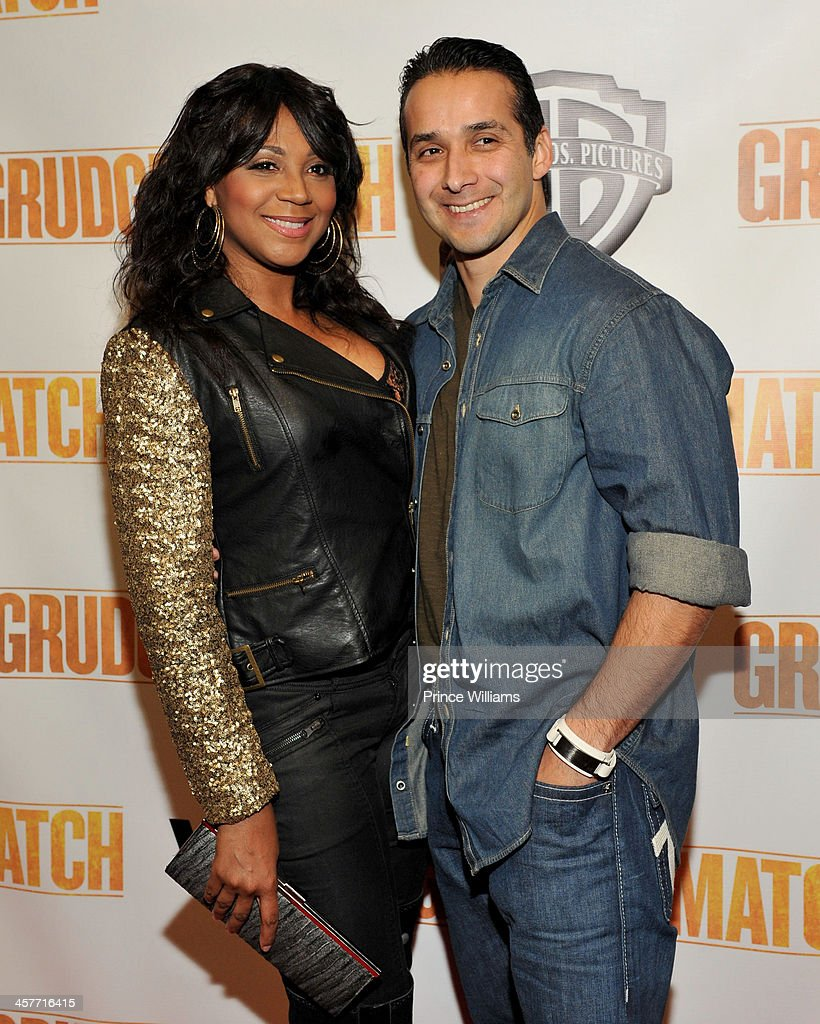 Trina Braxton and Gabe Solis attend the 'Grudge Match' screening at AMC Parkway Pointe on December 17 2013 in Atlanta Georgia