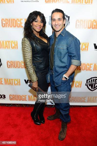 Trina Braxton and Gabe Solis attends the 'Grudge Match' screening at AMC Parkway Pointe on December 17 2013 in Atlanta Georgia