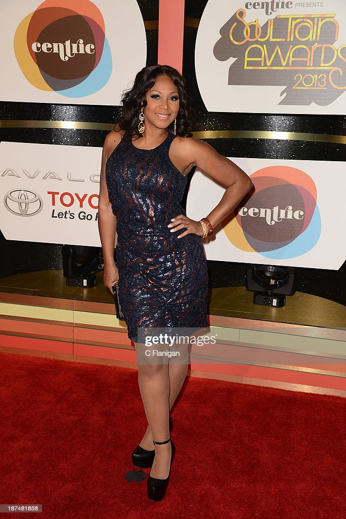 Trina Braxton arrives at the 2013 BET Soul Train Awards at the Orleans Arena on November 8 2013 in Las Vegas Nevada