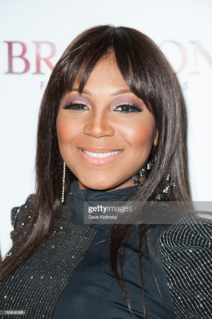 <a gi-track='captionPersonalityLinkClicked' href=/galleries/search?phrase=Trina+Braxton&family=editorial&specificpeople=5880827 ng-click='$event.stopPropagation()'>Trina Braxton</a> attends the 'Braxton Family Values' Season Three premiere party at STK Rooftop on March 13, 2013 in New York City.