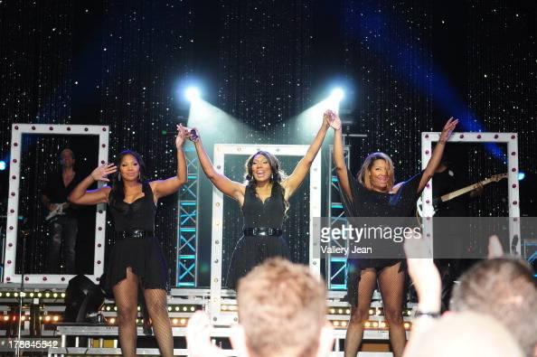 Trina Braxton Towanda Braxton and Tamar Braxton perform during Toni Braxton concert at James L Knight Center on August 29 2013 in Miami Florida