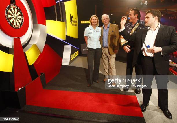 Trina Gulliver Johnny Ball Bobby George and Minister for further Education Sion Simon on stage before the World Darts Championship at Frimley Green...