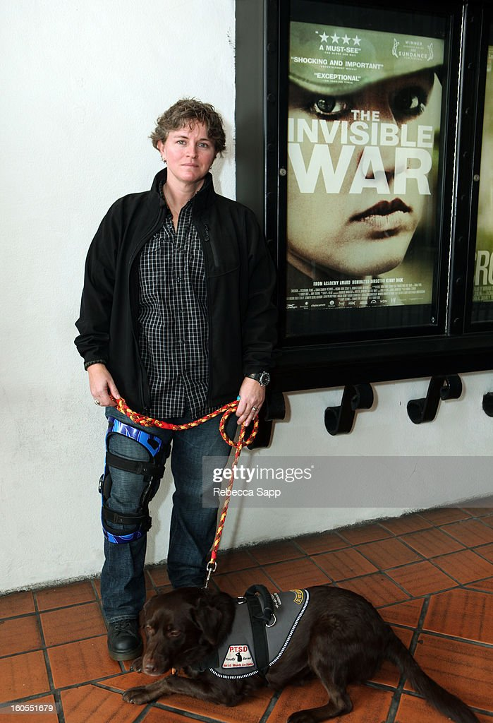 Trina McDonald and service dog Suzzie of the film 'The Invisible War' attend the 28th Santa Barbara International Film Festival on February 2, 2013 in Santa Barbara, California.