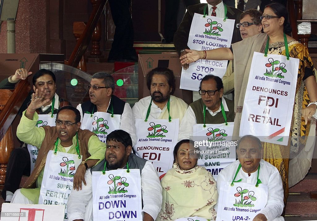 Trinamool congress MPs protesting in the front of Parliament House demanding 24 LPG gas cylinders to be provided on subsidy and against FDI before attending Parliament Winter Session on November 29, 2012 in New Delhi, India.