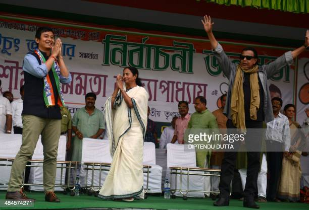 Trinamool Congress party canditate for Darjeeling constituency Baichung Bhutia gestures while India's West Bengal Chief Minister and TMC leader...