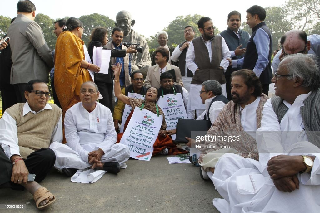 Trinamool Congress Party (TMC) gathered in front of the statue of Mahatma Gandhi demanding a room for the party's office at the Parliament House, on the first day of its winter session on November 22, 2012 in New Delhi, India. Parliament's winter session began on a stormy note as the issue of FDI in trade and reservation for ST/SC in promotion disrupted the Lok Sabha and Rajya Sabha.