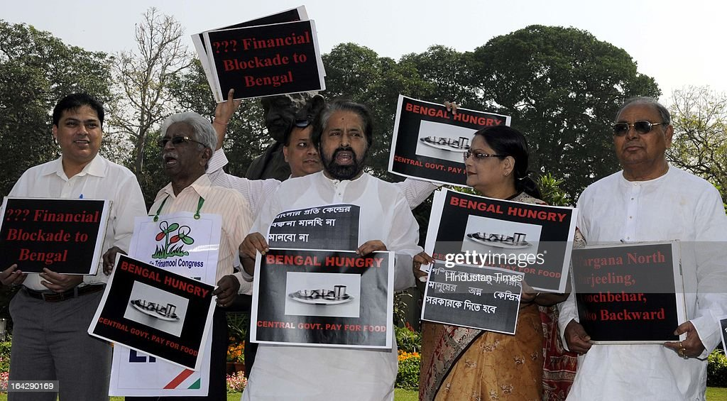 Trinamool Congress Party Members of Parliament hold placards while demanding a special package for West Bengal during a protest at Parliament on March 21, 2013 in New Delhi, India. Anti-Rape law was passed in Rajya Sabha after it got passed in Lok Sabha two days ago.