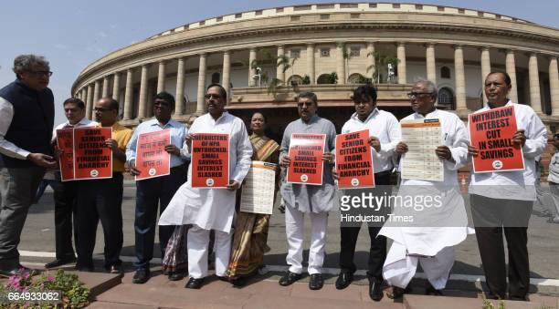 Trinamool Congress Party MPs staging a protest demanding with drawing interest cut in small savings and various other demands during the Parliament...