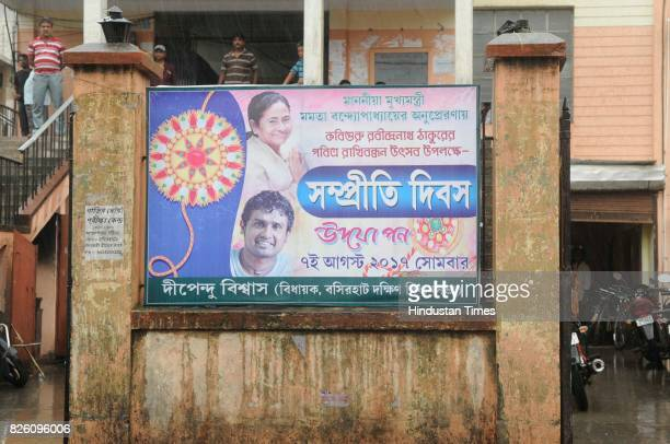 Trinamool Congress poster hang on wall wishing everybody Rakhi one month after communal clashes on August 3 2017 in Basirhat India The teens social...