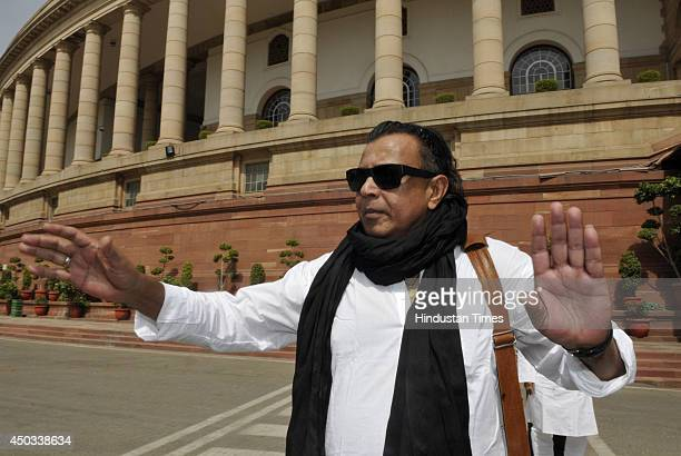 Trinamool Congress Rajya Sabha MP and Bollywood actor Mithun Chakraborty arrives at Parliament first time to attend Parliament session on June 9 2014...