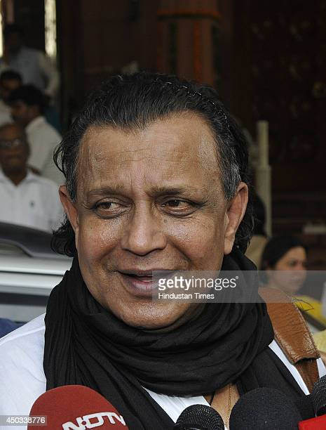 Trinamool Congress Rajya Sabha MP and Bollywood actor Mithun Chakraborty talks to media after attending special Parliament session on June 9 2014 in...