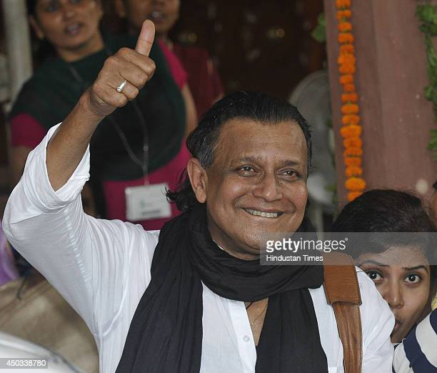 Trinamool Congress Rajya Sabha MP and Bollywood actor Mithun Chakraborty gestures to media after attending special Parliament session on June 9 2014...