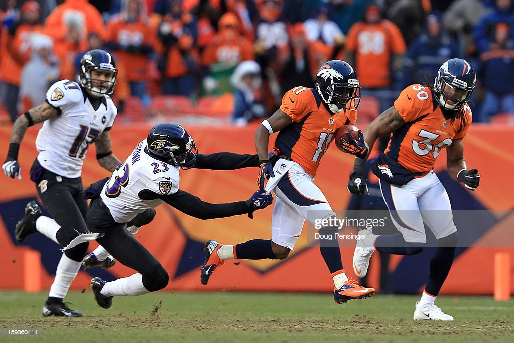 Trindon Holliday #11 of the Denver Broncos returns a kickoff 104 yards for a touchdown in the third quarter against Chykie Brown #23 of the Baltimore Ravens during the AFC Divisional Playoff Game at Sports Authority Field at Mile High on January 12, 2013 in Denver, Colorado.