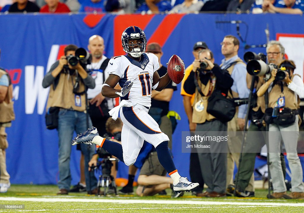 <a gi-track='captionPersonalityLinkClicked' href=/galleries/search?phrase=Trindon+Holliday&family=editorial&specificpeople=4045241 ng-click='$event.stopPropagation()'>Trindon Holliday</a> #11 of the Denver Broncos returns a punt for a touchdown in the second half against the New York Giants on September 15, 2013 at MetLife Stadium in East Rutherford, New Jersey. The Broncos defeated the Giants 41-23.