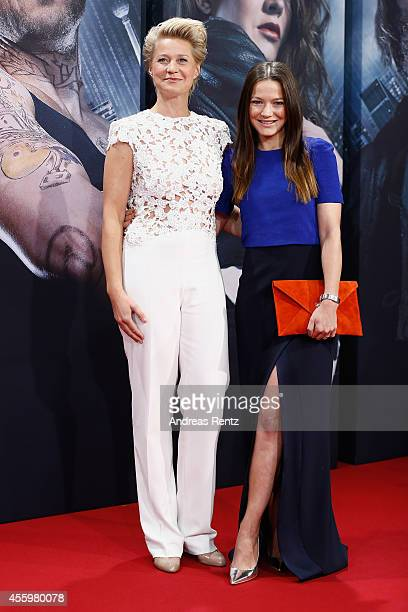 Trine Dyrholm and Hannah Herzsprung attend the premiere of the film 'Who am I' at Zoo Palast on September 23 2014 in Berlin Germany