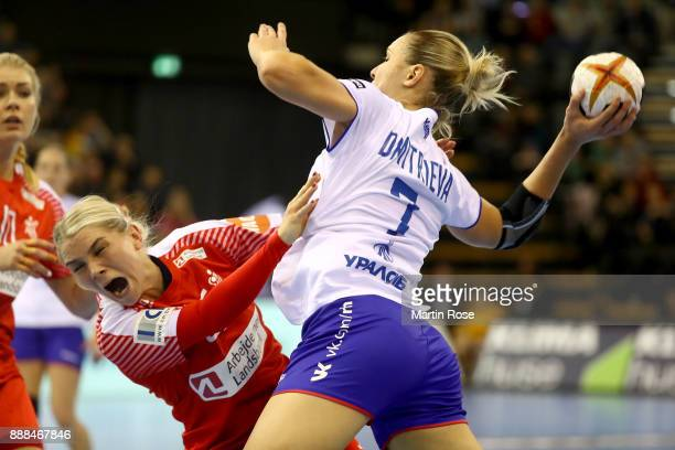 Trine Jensen of Denmark challenges Daria Dmitrieva of Russia during the IHF Women's Handball World Championship group C match between Denmark and...