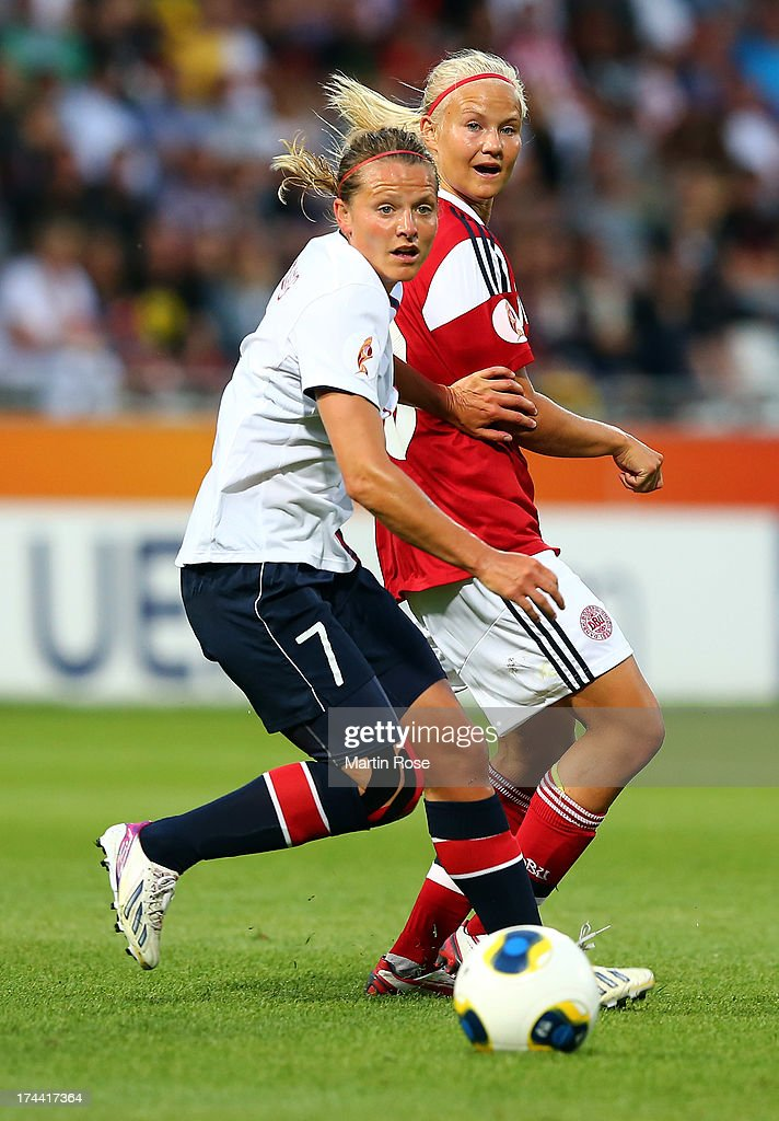 Trine Roenning (L) of Norway and Pernille Harder (R) of Denmark battle for the ball during the UEFA Women's Euro 2013 semi final match between Norway and Denmark at Nya Parken on July 25, 2013 in Norrkoping, Sweden.