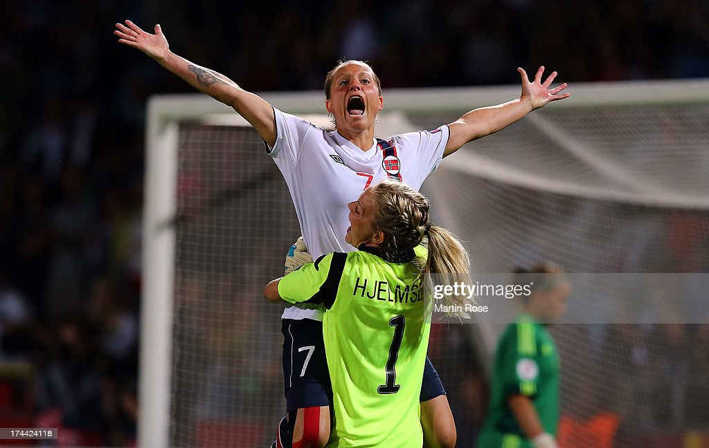 Trine Roenning (#7) of Norway celebrate with team mate Ingrid Hjelmseth after winning the UEFA Women's Euro 2013 semi final match between Norway and Denmark at Nya Parken on July 25, 2013 in Norrkoping, Sweden.