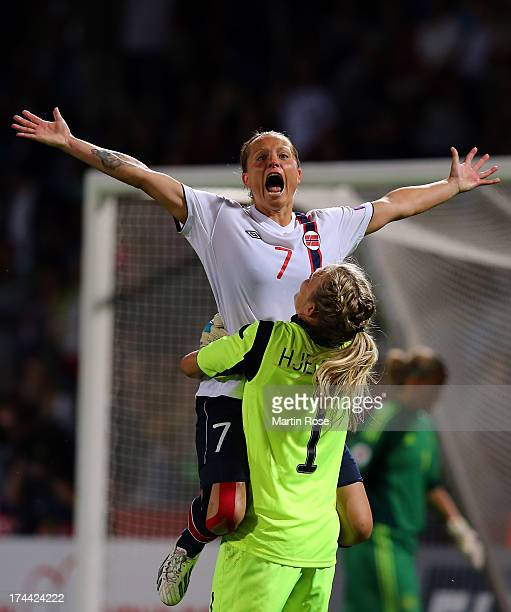 Trine Roenning of Norway celebrate with team mate Ingrid Hjelmseth after winning the UEFA Women's Euro 2013 semi final match between Norway and...