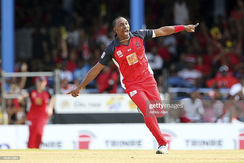 Trinidad and Tobago captain <a gi-track='captionPersonalityLinkClicked' href=/galleries/search?phrase=Dwayne+Bravo&family=editorial&specificpeople=178945 ng-click='$event.stopPropagation()'>Dwayne Bravo</a> celebrates getting a wicket during a match between The Trinidad and Tobago Red Steel and St. Lucia Zouks as part of the week 3 of Caribbean Premier League 2014 at Queen's Park Oval on July 27, 2014 in Port of Spain, Trinidad & Tobago.
