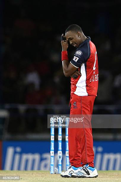 Trinidad and Tobago captain Dwayne Bravo reflects on his teams bowling effort during a match between The Trinidad and Tobago Red Steel and Guyana...