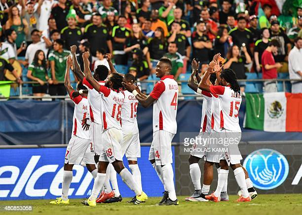 Trinidad and Tobago celebrate after their 44 draw against Mexico during a CONCACAF Gold Cup Group C match in Charlotte North Carolina on July 15 2015...