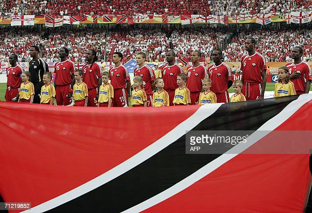 Trinidad and Tobago football team stands during their national anthem prior to the 2006 World Cup group B football game England vs Trinidad and...