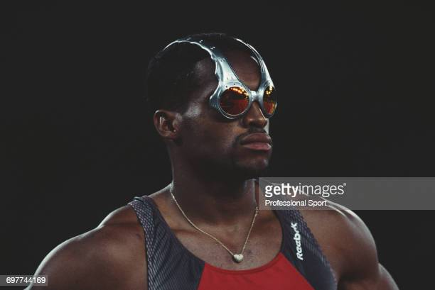 Trinidad and Tobago track athlete Ato Boldon pictured wearing Oakley 'Over the top' sunglasses during competition to finish in second place to win...