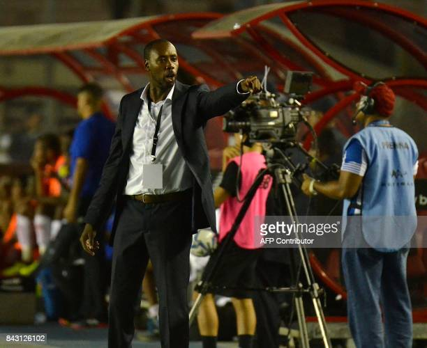 Trinidad and Tobago's coach Dennis Lawrence gives instructions during the 2018 World Cup football qualifier match against Panama in Panama City on...