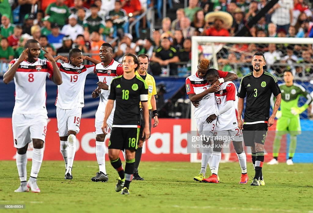 Trinidad and Tobago's Keron Cummings and Joevin Jones celebrate Cummings' goal against Mexico during a CONCACAF Gold Cup Group C match in Charlotte...