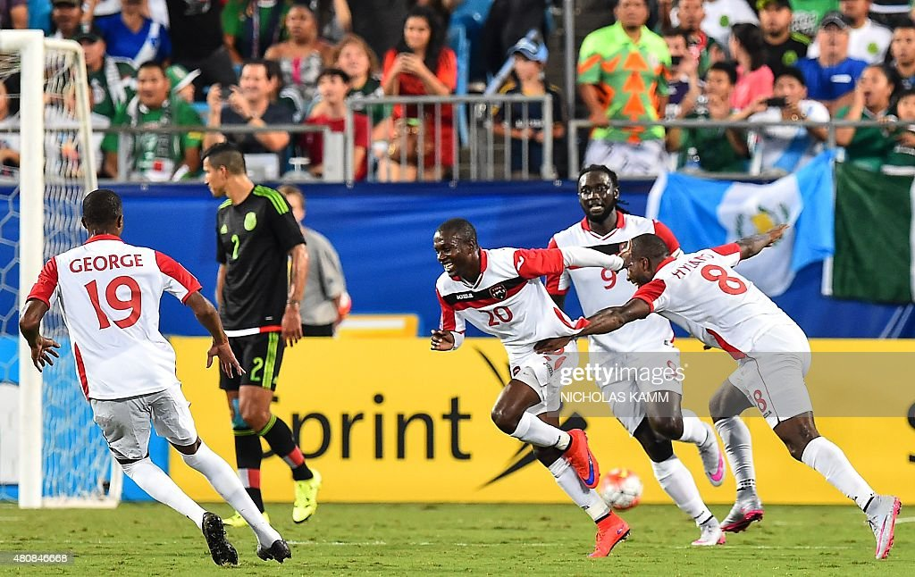 Trinidad and Tobago's Keron Cummings celebrates scoring against Mexico during a CONCACAF Gold Cup Group C match in Charlotte North Carolina on July...
