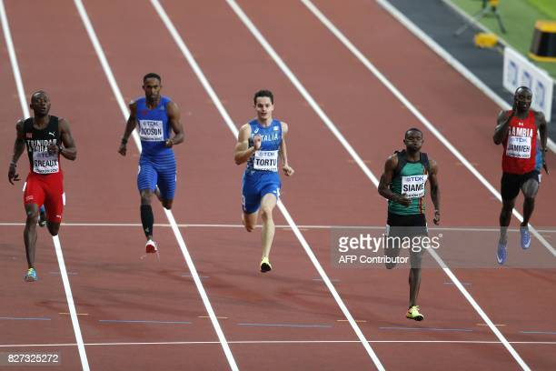 Trinidad and Tobago's Kyle Greaux Samoa's Jeremy Dodson Italy's Filippo Tortu Zambia's Sydney Siame and Gambia's Adama Jammeh compete in the heats of...