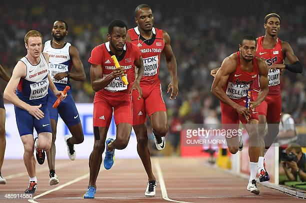 Trinidad and Tobago's Lalonde Gordon runs next to the USA's Bryshon Nellum and Britain's Jarryd Dunn in the final of the men's 4x400 metres athletics...