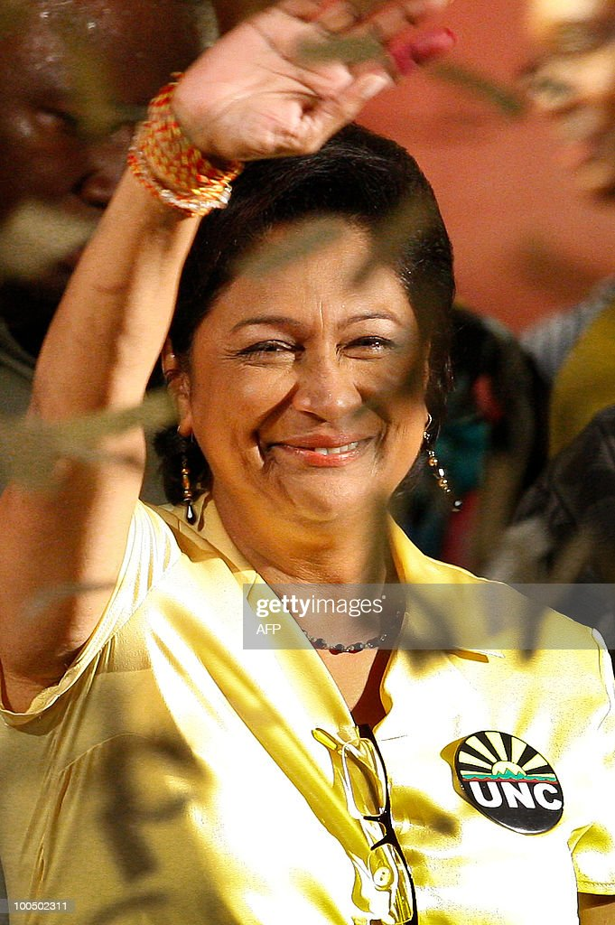 Trinidad and Tobago's opposition leader Kamla Persad-Bissessar makes a gesture of victory after winning the election at the UNC party headquarters in Couva Town in Trinidad, on May 24, 2010. Persad-Bissessar has been elected the first female prime minister of Trinidad and Tobago after her five-party coalition swept to victory in snap elections in the former British colony.