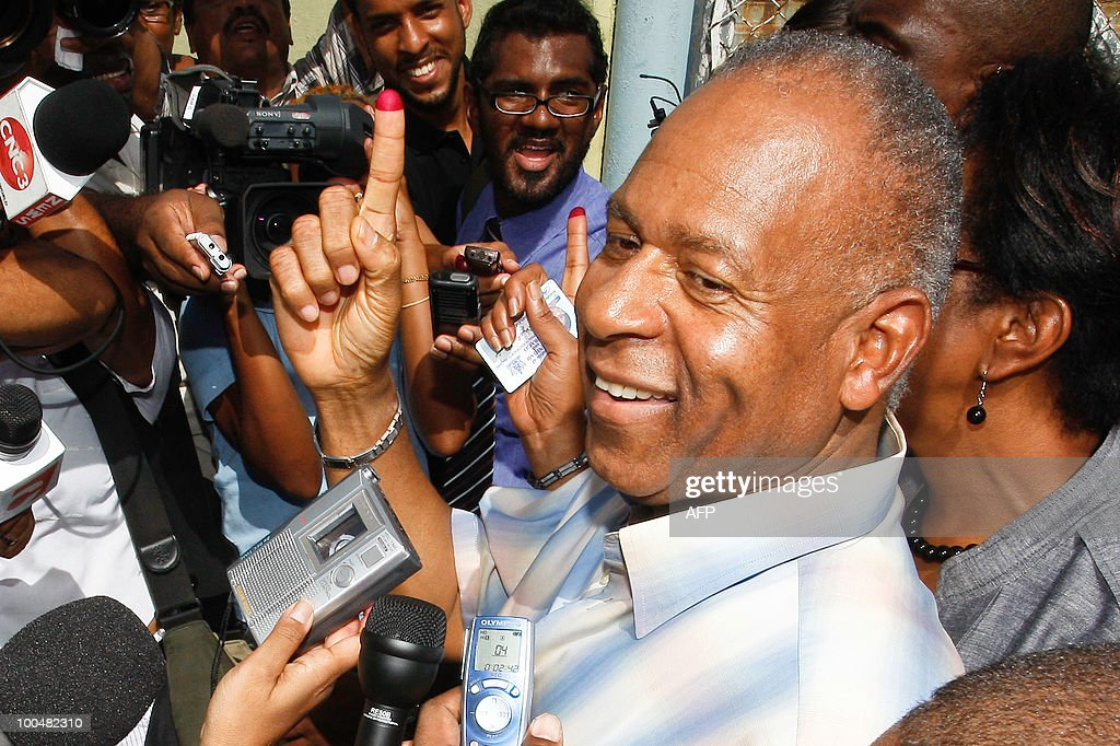 Trinidad and Tobago's PM Patrick Manning shows his dyed right index finger after casting his vote during the general elections May 24, 2010 in Port of Spain.