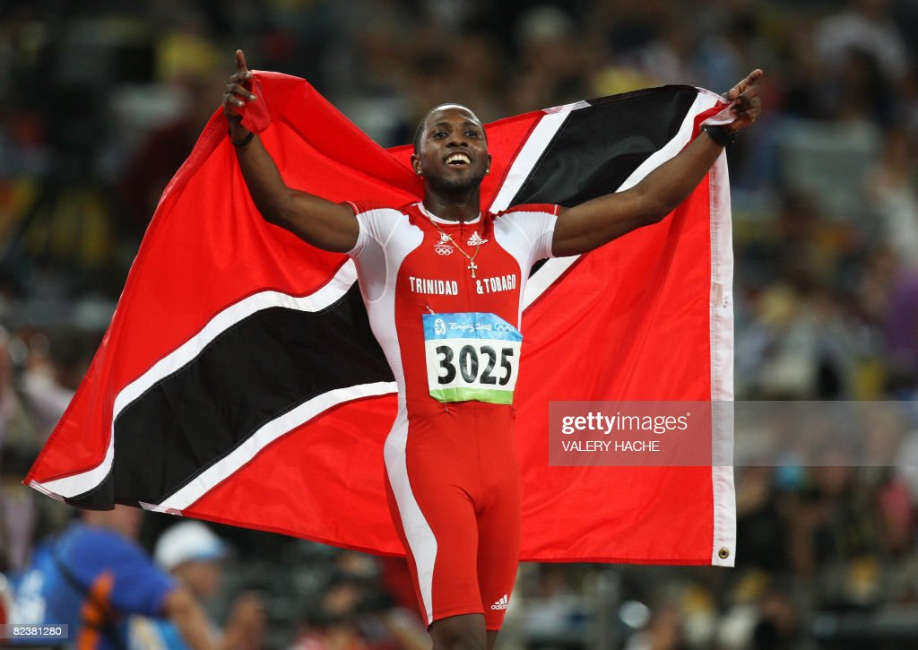 Trinidad and Tobago's Richard Thompson celebrates after winning silver in the men's 100m final at the 'Bird's Nest' National Stadium as part of the 2008 Beijing Olympic Games on August 16, 2008. Jamaica's Usain Bolt won the Olympic Games men's 100m gold medal in a new world record time of 9.69sec. Thompson (9.89sec) and Walter Dix of the US (9.91) took silver and bronze respectively.