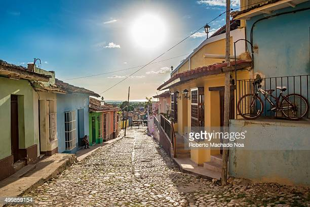Trinidad de Cuba scenes Colorful houses along a cobbled street The houses depict the colonial architecture and culture in Cuba Trinidad is one of the...