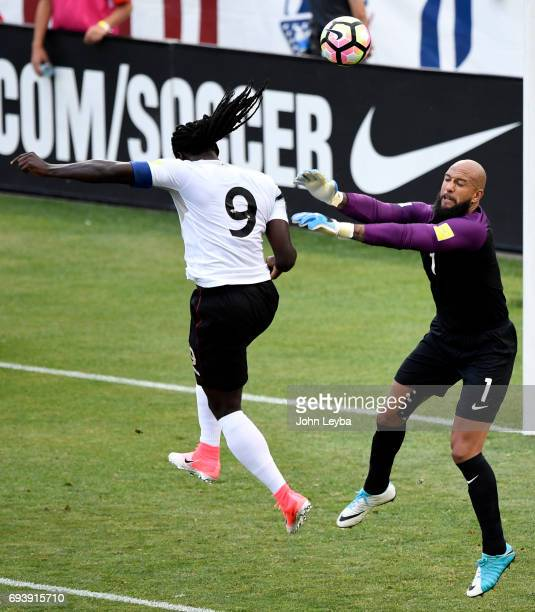 Trinidad Tobago forward Kenwyne Jones attempts a headers over United States goalkeeper Tim Howard during the first half on June 8 2017 during a World...