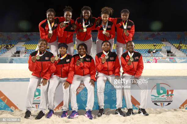 Trinidad Tobago pose after the medals ceremony after the girl's beach soccer gold medal final match between Trinidad Tobago and Jamaica on day 5 of...