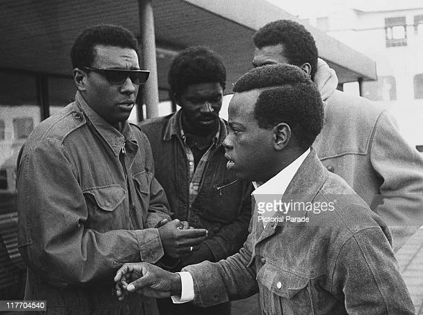 Trinidadborn American black activist Stokely Carmichael with an old schoolmate William Percelll on a quayside in Malmo Sweden December 1967...
