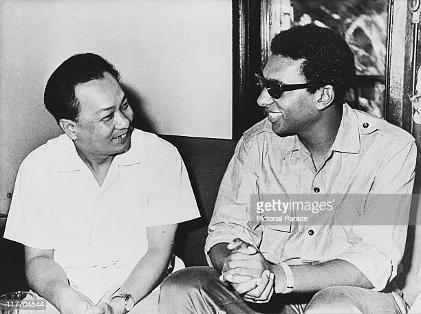 Trinidadborn American black activist Stokely Carmichael with Vu Quang First Secretary of the Central Committee of the Vietnamese Working Youth's...