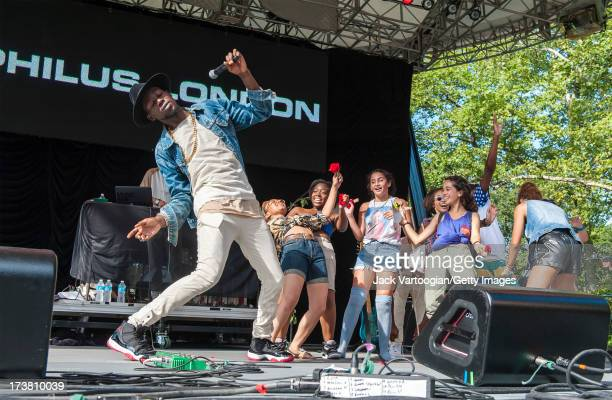Trinidadborn Brooklynbred Rapper/MC Theophilus London closes his set with young fans from the audience on stage at Central Park SummerStage New York...